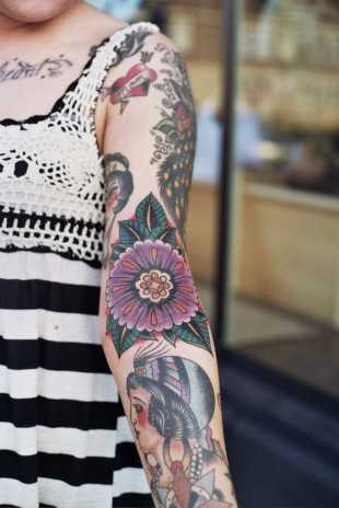 Floral and Portrait Sleeve Tattoo